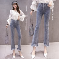 牛仔裤女不规则春季新款韩版高腰弹力修身流苏微喇叭裤九分裤