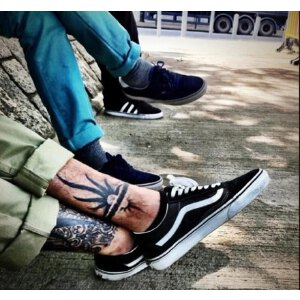 正品季万斯男鞋低帮真皮板鞋帆布鞋女黑白滑板鞋经典款
